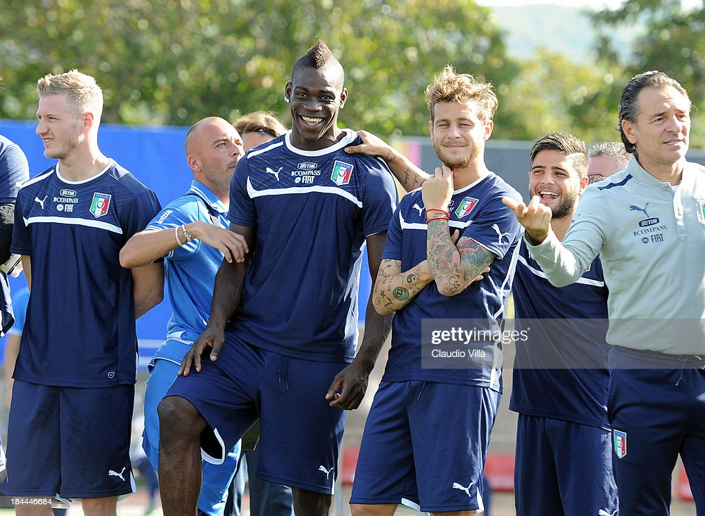 <a gi-track='captionPersonalityLinkClicked' href=/galleries/search?phrase=Mario+Balotelli&family=editorial&specificpeople=4940446 ng-click='$event.stopPropagation()'>Mario Balotelli</a> of Italy (C) smiles before of a training session, ahead of their FIFA World Cup qualifier against Armenia, on October 14, 2013 in Naples, Italy. The training session was organised at Quarto, a football pitch built on land confiscated from the Camorra - the Neapolitan Mafia, as part of the fight against the mafia.
