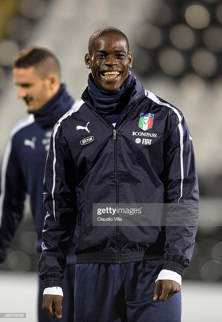 <a gi-track='captionPersonalityLinkClicked' href=/galleries/search?phrase=Mario+Balotelli&family=editorial&specificpeople=4940446 ng-click='$event.stopPropagation()'>Mario Balotelli</a> of Italy smiles during a training session at Craven Cottage on November 17, 2013 in London, England.