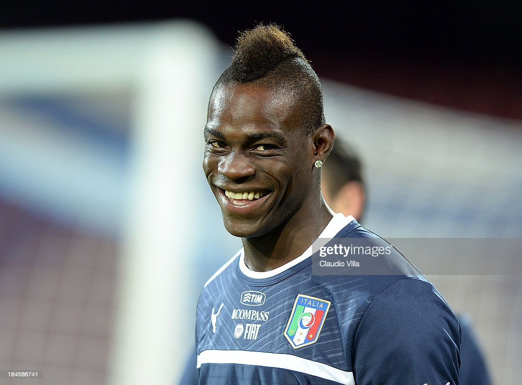 <a gi-track='captionPersonalityLinkClicked' href=/galleries/search?phrase=Mario+Balotelli&family=editorial&specificpeople=4940446 ng-click='$event.stopPropagation()'>Mario Balotelli</a> of Italy smiles during a training session on October 14, 2013 in Naples, Italy.