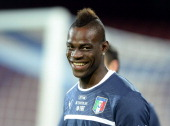 Mario Balotelli of Italy smiles during a training session on October 14 2013 in Naples Italy