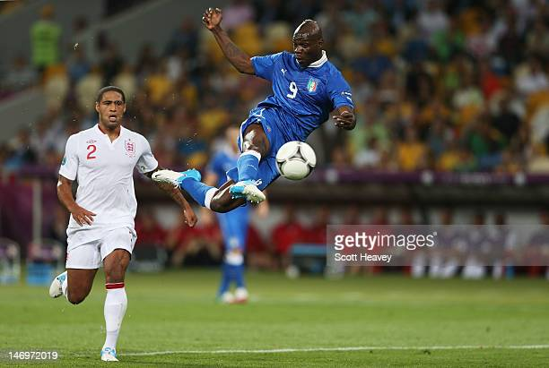 Mario Balotelli of Italy strikes the ball as Glen Johnson of England looks on during the UEFA EURO 2012 quarter final match between England and Italy...