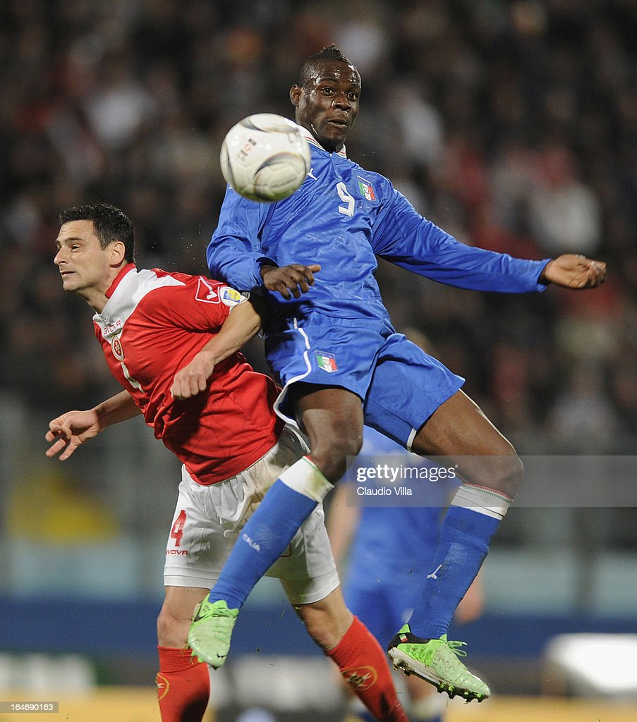 <a gi-track='captionPersonalityLinkClicked' href=/galleries/search?phrase=Mario+Balotelli&family=editorial&specificpeople=4940446 ng-click='$event.stopPropagation()'>Mario Balotelli</a> of Italy#9 and Gareth Sciberras of Malta compete for the ball during the FIFA 2014 World Cup qualifier match between Malta and Italy at Ta Qali Stadium on March 26, 2013 in Malta, Malta.