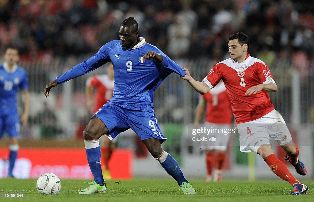 Mario Balotelli of Italy#9 and Gareth Sciberras of Malta compete for the ball during the FIFA 2014 World Cup qualifier match between Malta and Italy at Ta Qali Stadium on March 26, 2013 in Malta, Malta.