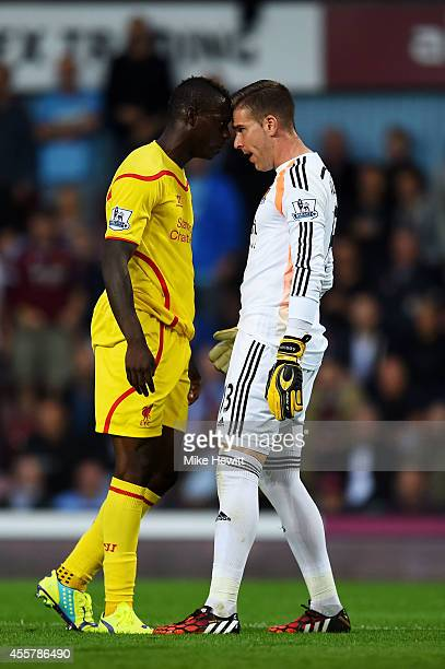 Mario Balotelli of Liverpool and Adrian of West Ham clash following a heavy tackle by Balotelli on Adrian during the Barclays Premier League match...
