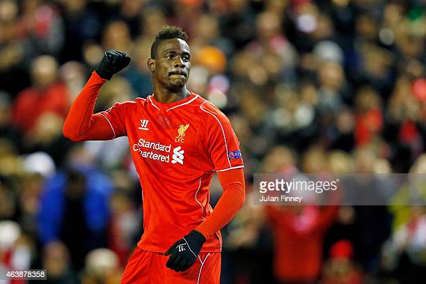 Mario Balotelli of Liverpool celebrates after scoring the opening goal from the penalty spot during the UEFA Europa League Round of 32 match between...