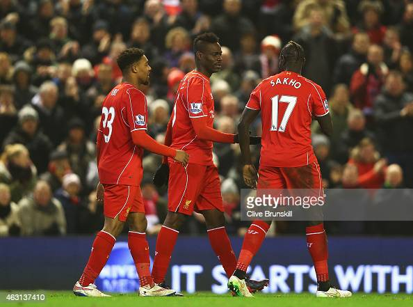 Mario Balotelli of Liverpool celebrates his goal with team mates during the Barclays Premier League match between Liverpool and Tottenham Hotspur at...