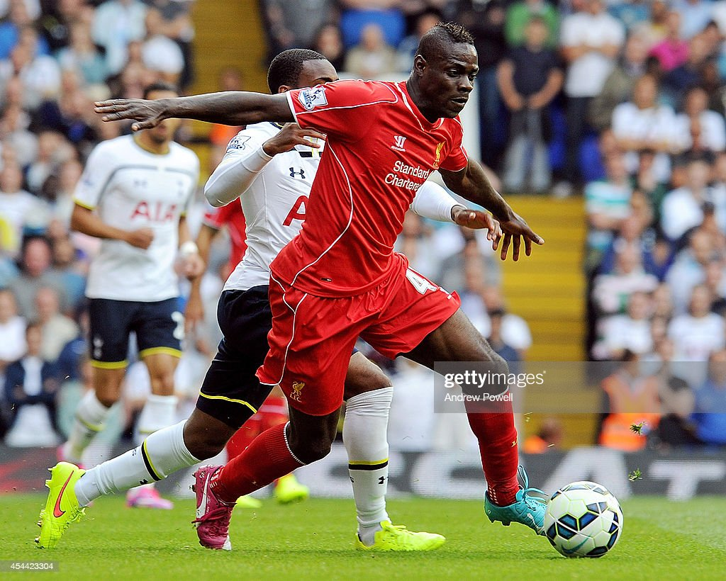 <a gi-track='captionPersonalityLinkClicked' href=/galleries/search?phrase=Mario+Balotelli&family=editorial&specificpeople=4940446 ng-click='$event.stopPropagation()'>Mario Balotelli</a> of Liverpool competes with Danny Rose of Tottenham Hotspur during the Barclays Premier League match between Tottenham Hotspur and Liverpool at White Hart Lane on August 31, 2014 in London, England.