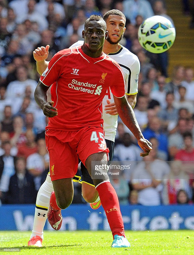 Mario Balotelli of Liverpool competes with Etienne Capoue of Tottenham Hotspur during the Barclays Premier League match between Tottenham Hotspur and Liverpool at White Hart Lane on August 31, 2014 in London, England.