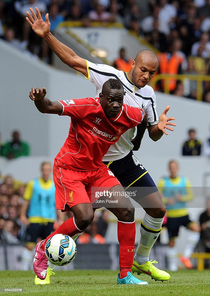 Mario Balotelli of Liverpool competes with Younes Kaboul of Tottenham Hotspur during the Barclays Premier League match between Tottenham Hotspur and Liverpool at White Hart Lane on August 31, 2014 in London, England.