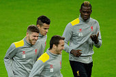 Mario Balotelli of Liverpool FC exercises with teammates Javier Manquillo Alberto Moreno and Philippe Coutinho during the training session ahead of...