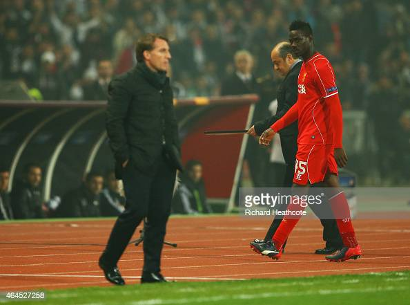 Mario Balotelli of Liverpool looks across as Brendan Rodgers manager of Liverpool as he is substituted during the UEFA Europa League Round of 32...