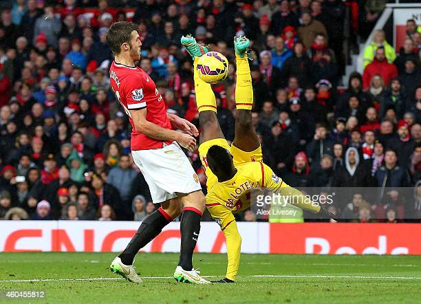 Mario Balotelli of Liverpool performs an overhead kick during the Barclays Premier League match between Manchester United and Liverpool at Old...