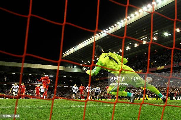 Mario Balotelli of Liverpool scores the match winning goal past goalkeeper Cenk Gonen of Besiktas during the UEFA Europa League Round of 32 match...