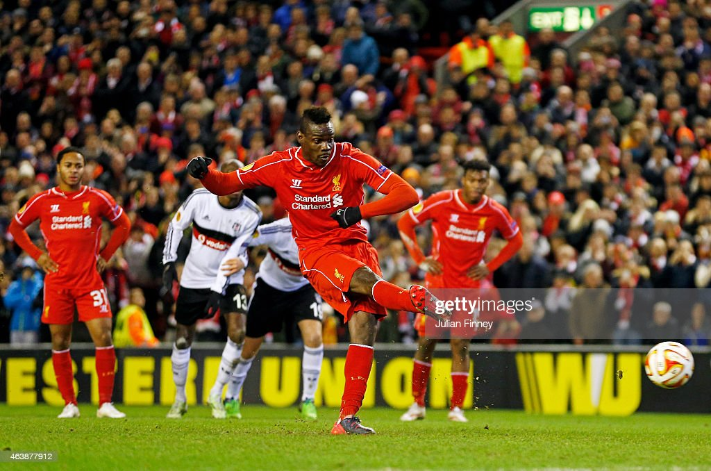 Mario Balotelli of Liverpool scores the opening goal from the penalty spot during the UEFA Europa League Round of 32 match between Liverpool FC and Besiktas JK at Anfield on February 19, 2015 in Liverpool, United Kingdom.