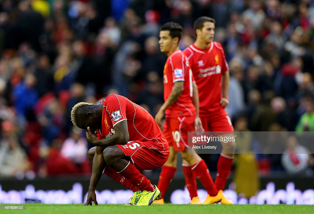 Mario Balotelli of Liverpool shows his frustration after a missed opportunity during the Barclays Premier League match between Liverpool and Hull...