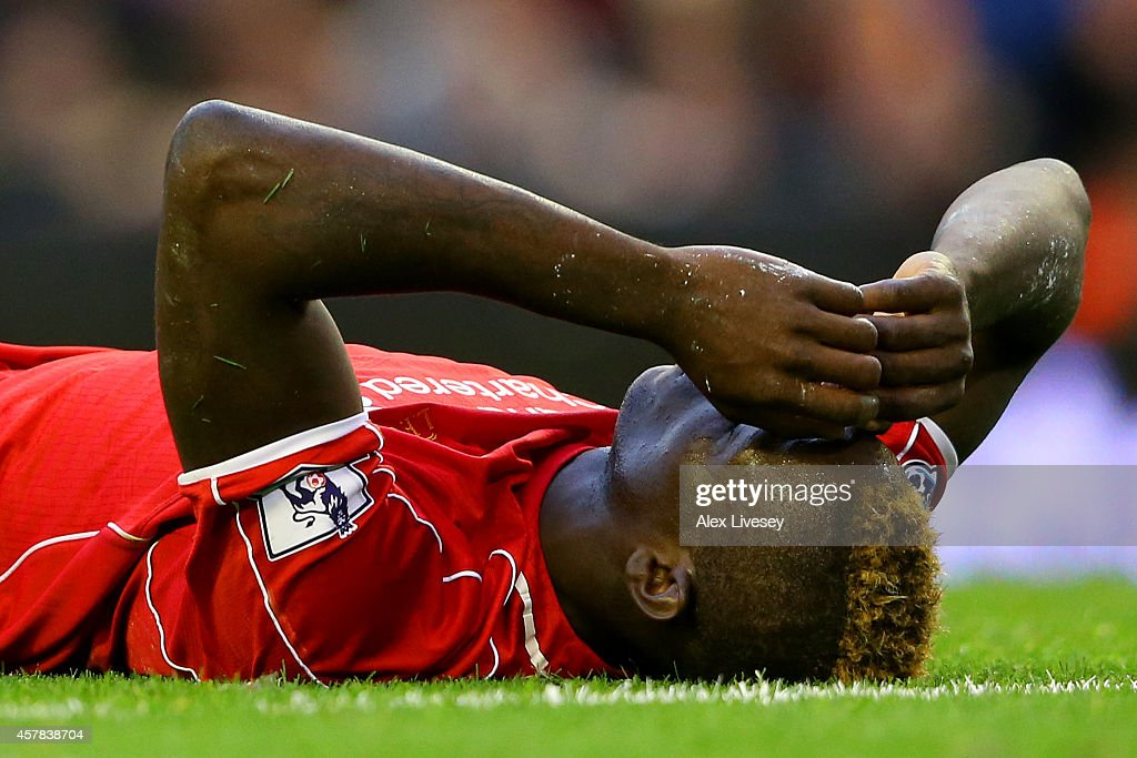 Mario Balotelli of Liverpool shows his frustration during the Barclays Premier League match between Liverpool and Hull City at Anfield on October 25...