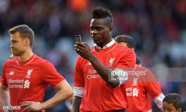 Mario Balotelli of Liverpool takes pictures of the fans on his phone after the Barclays Premier League match betrween Liverpool and Crystal Palace at...