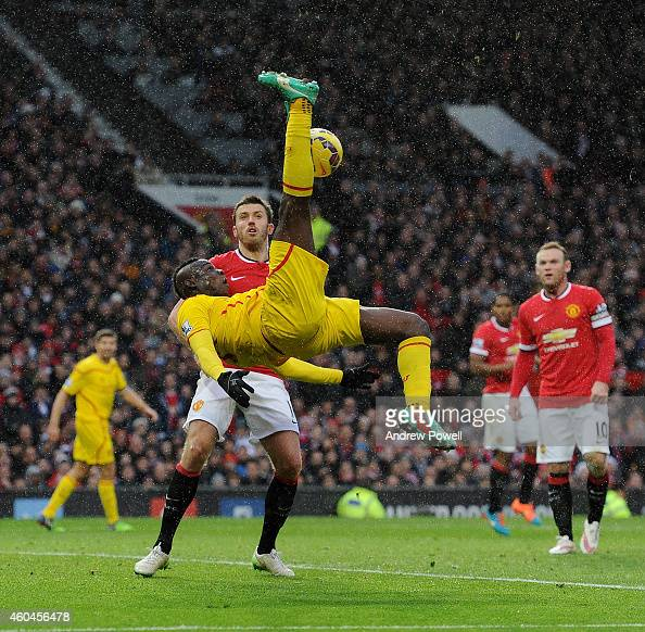 Mario Balotelli of Liverpool tries an overhead kick during the Barclays Premier League match between Manchester United and Liverpool at Old Trafford...