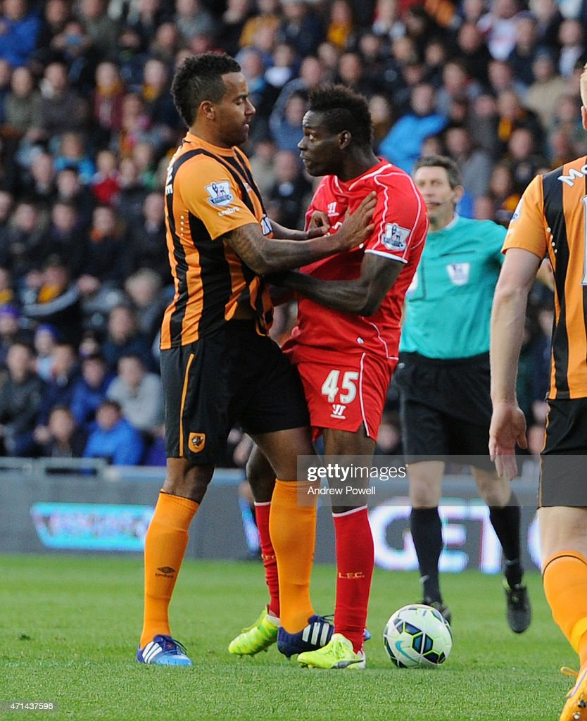 Mario Balotelli (R) of Liverpool tustles with Tom Huddlestone of Hull City during the Barclays Premier League match between Hull City and Liverpool at KC Stadium on April 28, 2015 in Hull, England.