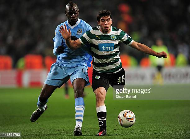 Mario Balotelli of Man City fights for the ball with Emiliano Insua of Sporting Lisbon during the UEFA Europa League round of 16 second leg match...