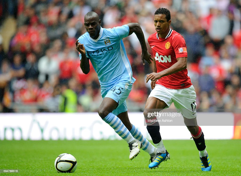 Mario Balotelli of Manchester City and Nani of Manchester United