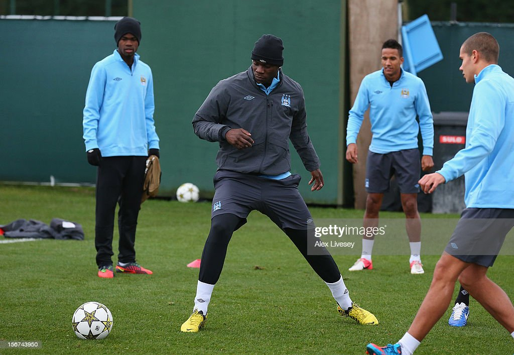 Mario Balotelli of Manchester City attempts to cut out a pass during a training session at Carrington Training Ground on November 20, 2012 in Manchester, England.
