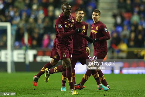 Mario Balotelli of Manchester City celebrates after scoring his sides opening goal during the Barclays Premier League match between Wigan Athletic...