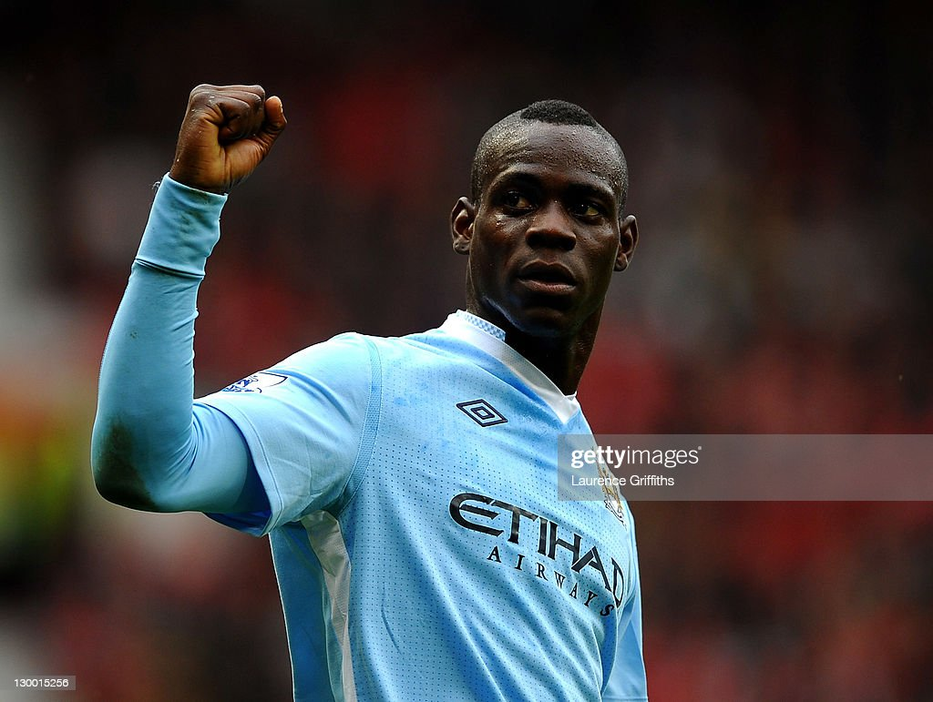Mario Balotelli of Manchester City celebrates scoring his team's second goal during the Barclays Premier League match between Manchester United and Manchester City at Old Trafford on October 23, 2011 in Manchester, England.