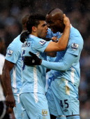 Mario Balotelli of Manchester City celebrates scoring his team's third goal from a penalty with Sergio Aguero during the Barclays Premier League...