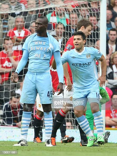 Mario Balotelli of Manchester City celebrates scoring their first goal during the Barclays Premier League match between Manchester United and...