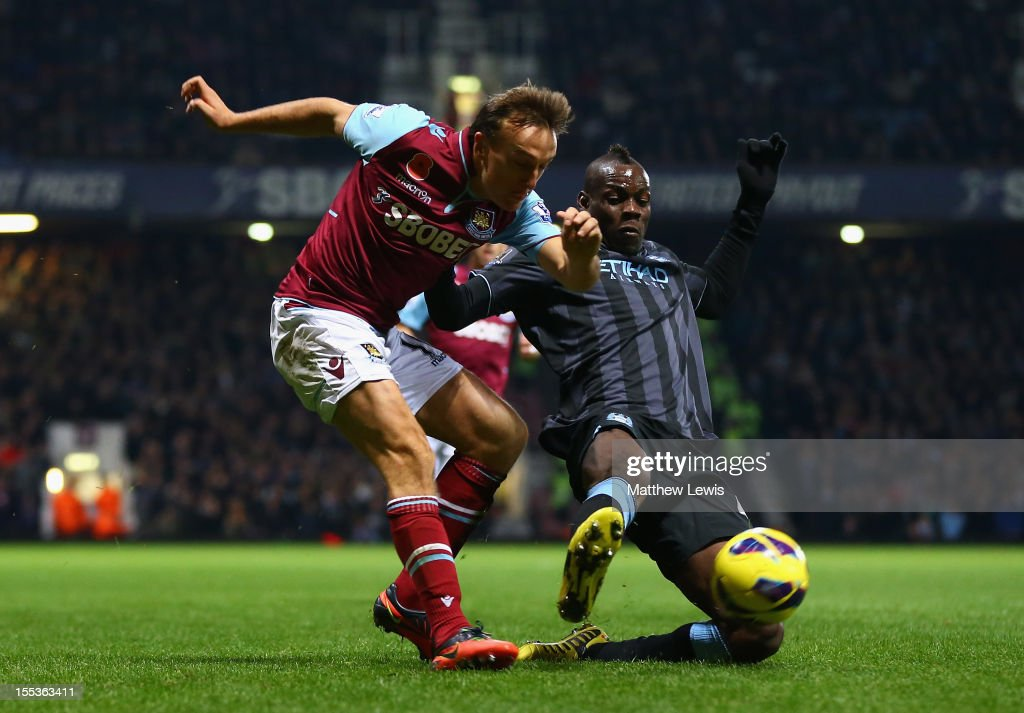 <a gi-track='captionPersonalityLinkClicked' href=/galleries/search?phrase=Mario+Balotelli&family=editorial&specificpeople=4940446 ng-click='$event.stopPropagation()'>Mario Balotelli</a> of Manchester City challenges <a gi-track='captionPersonalityLinkClicked' href=/galleries/search?phrase=Mark+Noble&family=editorial&specificpeople=844055 ng-click='$event.stopPropagation()'>Mark Noble</a> of West Ham United during the Barclays Premier League match between West Ham United and Manchester City at the Boleyn Ground on November 3, 2012 in London, England.