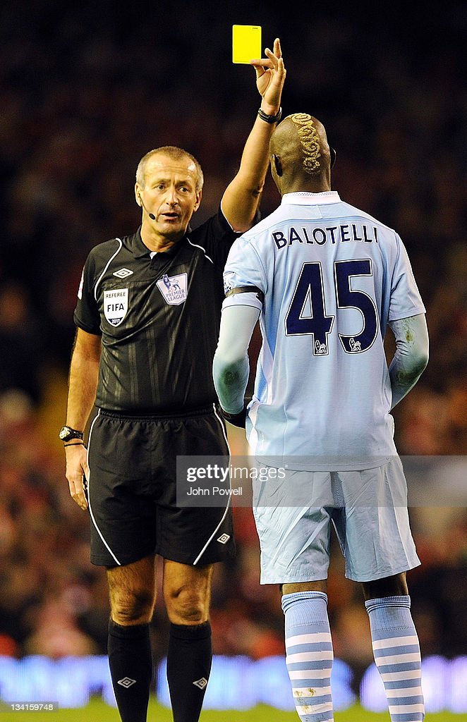 <a gi-track='captionPersonalityLinkClicked' href=/galleries/search?phrase=Mario+Balotelli&family=editorial&specificpeople=4940446 ng-click='$event.stopPropagation()'>Mario Balotelli</a> of Manchester City gets a yellow during the Barclays Premier League match between Liverpool and Manchester City at Anfield on November 27, 2011 in Liverpool, England.