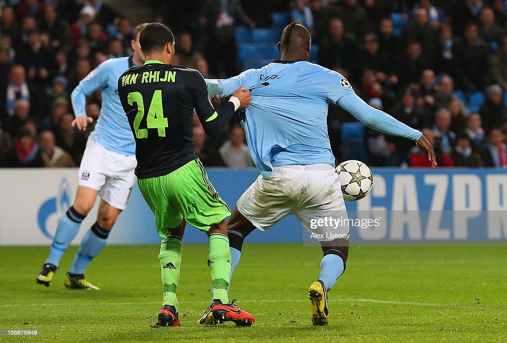 <a gi-track='captionPersonalityLinkClicked' href=/galleries/search?phrase=Mario+Balotelli&family=editorial&specificpeople=4940446 ng-click='$event.stopPropagation()'>Mario Balotelli</a> of Manchester City has his shirt pulled by Ricardo van Rhijn of Ajax in the penalty box during the UEFA Champions League Group D match between Manchester City FC and Ajax Amsterdam at the Etihad Stadium on November 6, 2012 in Manchester, England.