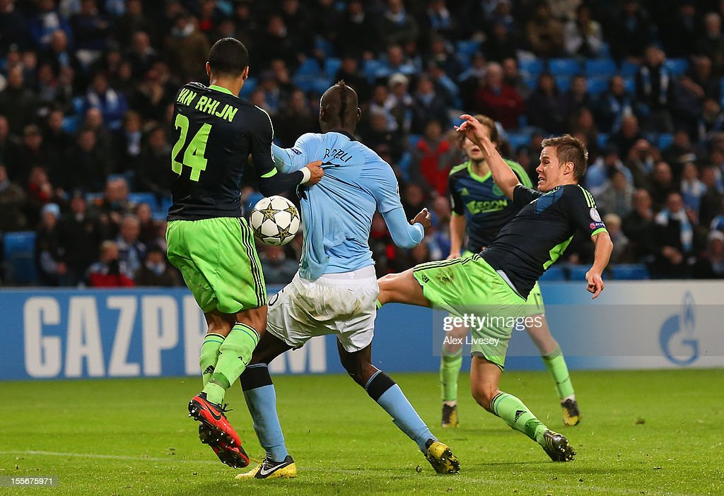 Mario Balotelli of Manchester City has his shirt pulled by Ricardo van Rhijn of Ajax in the penalty box during the UEFA Champions League Group D match between Manchester City FC and Ajax Amsterdam at the Etihad Stadium on November 6, 2012 in Manchester, England.