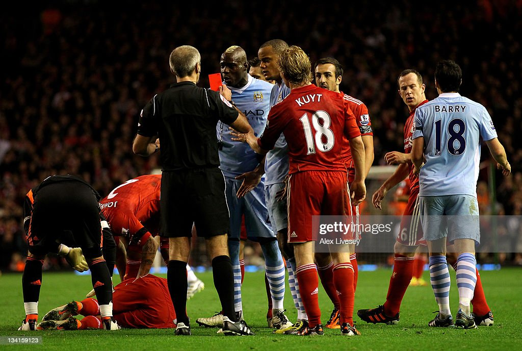 <a gi-track='captionPersonalityLinkClicked' href=/galleries/search?phrase=Mario+Balotelli&family=editorial&specificpeople=4940446 ng-click='$event.stopPropagation()'>Mario Balotelli</a> of Manchester City is shown a red card by Referee Martin Atkinson during the Barclays Premier League match between Liverpool and Manchester City at Anfield on November 27, 2011 in Liverpool, England.
