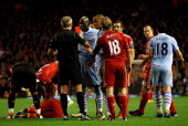 Mario Balotelli of Manchester City is shown a red card by Referee Martin Atkinson during the Barclays Premier League match between Liverpool and...