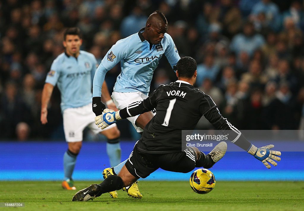 <a gi-track='captionPersonalityLinkClicked' href=/galleries/search?phrase=Mario+Balotelli&family=editorial&specificpeople=4940446 ng-click='$event.stopPropagation()'>Mario Balotelli</a> of Manchester City looks for a way past <a gi-track='captionPersonalityLinkClicked' href=/galleries/search?phrase=Michel+Vorm&family=editorial&specificpeople=6243381 ng-click='$event.stopPropagation()'>Michel Vorm</a> of Swansea City during the Barclays Premier League match between Manchester City and Swansea City at the Etihad Stadium on October 27, 2012 in Manchester, England.