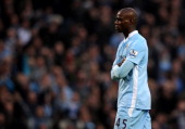 Mario Balotelli of Manchester City looks on after scoring the opening goal during the Barclays Premier League match between Manchester City and...