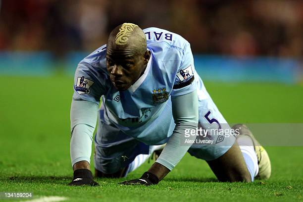 Mario Balotelli of Manchester City looks on during the Barclays Premier League match between Liverpool and Manchester City at Anfield on November 27...