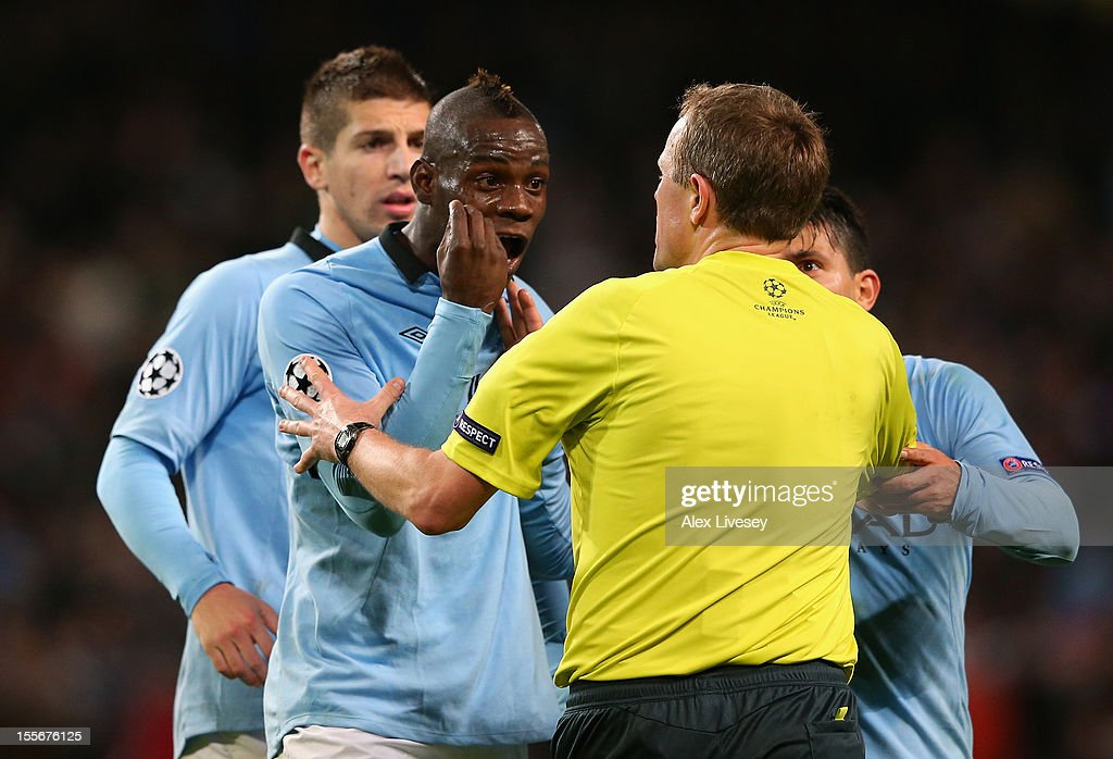 Mario Balotelli of Manchester City protests to Referee Peter Rasmussen after he denied him a penalty during the UEFA Champions League Group D match between Manchester City FC and Ajax Amsterdam at the Etihad Stadium on November 6, 2012 in Manchester, England.