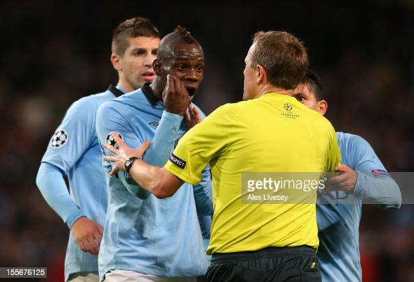 Mario Balotelli of Manchester City protests to Referee Peter Rasmussen after he denied him a penalty during the UEFA Champions League Group D match...