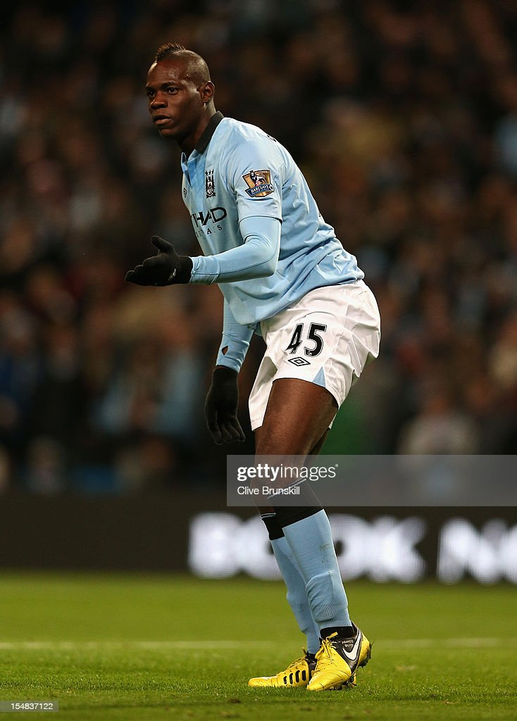 <a gi-track='captionPersonalityLinkClicked' href=/galleries/search?phrase=Mario+Balotelli&family=editorial&specificpeople=4940446 ng-click='$event.stopPropagation()'>Mario Balotelli</a> of Manchester City reacts during the Barclays Premier League match between Manchester City and Swansea City at the Etihad Stadium on October 27, 2012 in Manchester, England.