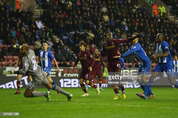 Mario Balotelli of Manchester City scores his sides opening goal during the Barclays Premier League match between Wigan Athletic and Manchester City...