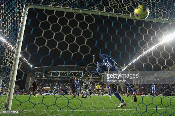 Mario Balotelli of Manchester City scores his sides opening goal despite the attempt to block on the line by Maynor Figueroa during the Barclays...