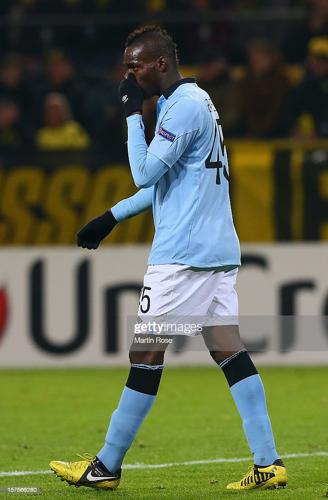 <a gi-track='captionPersonalityLinkClicked' href=/galleries/search?phrase=Mario+Balotelli&family=editorial&specificpeople=4940446 ng-click='$event.stopPropagation()'>Mario Balotelli</a> of Manchester reacts during the UEFA Champions League group D match between Borussia Dortmund and Manchester City at Signal Iduna Park on December 4, 2012 in Dortmund, Germany.