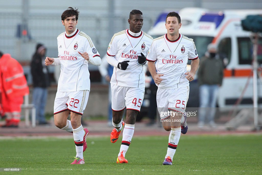 Mario Balotelli of Milan celebrates with team-mates after scoring their first goal during the Serie A match between Cagliari Calcio and AC Milan at Stadio Sant'Elia on January 26, 2014 in Cagliari, Italy.