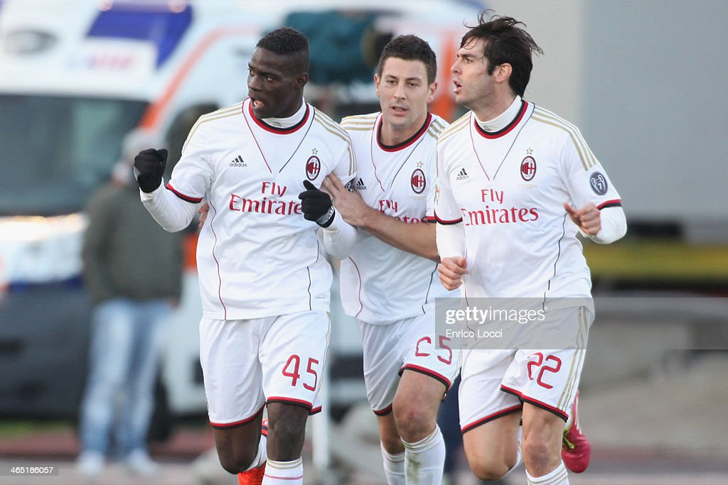 Mario Balotelli of Milan celebrates with team-mates Daniele Bonera and Kaka after scoring their first goal during the Serie A match between Cagliari Calcio and AC Milan at Stadio Sant'Elia on January 26, 2014 in Cagliari, Italy.