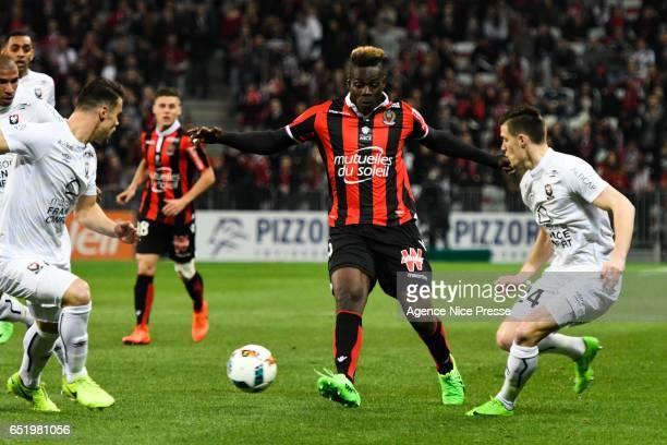 Mario Balotelli of Nice and Damien Da Silva and Frederic Guilbert of Caen during the Ligue 1 match between OGC Nice and SM Caen at Allianz Riviera on...