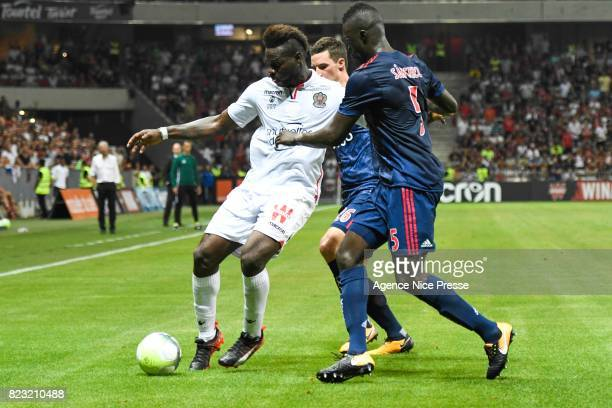 Mario Balotelli of Nice and Davinson Sanchez Mina of Ajax Amsterdam during the UEFA Champions League Qualifying match between Nice and Ajax Amsterdam...