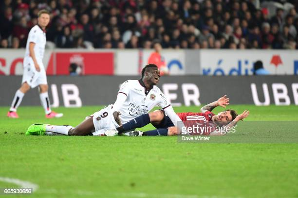 Mario Balotelli of Nice is penalised for a foul on Xeka of Lille during the French Ligue 1 match between Lille OSC and OGC Nice at Stade PierreMauroy...